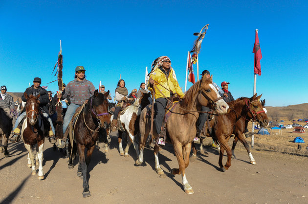 Horse riders from the Bigfoot Riders, Dakota 38 Riders, Spirit Riders and the Bigfoot Youth Riders arrive at the Oceti Sakowin camp during a protest of the Dakota Access pipeline on the Standing Rock Indian Reservation near Cannon Ball, North Dakota November 5, 2016. REUTERS/Stephanie Keith
